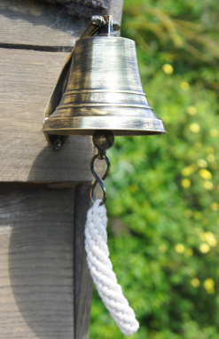 Antique Brass Ships Bell on Wall Outside