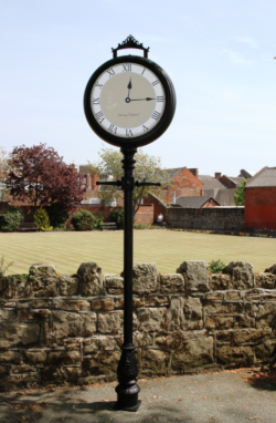 Bespoke lamp post clock in front of field
