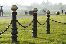 Cast Iron bollard and spiked chain on car park