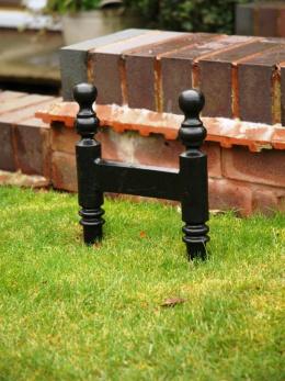 Simple design cast iron shoe scraper in garden