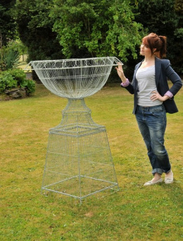 green wire planter with lady