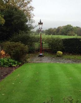 Reclaimed victorian railway lamp post in garden