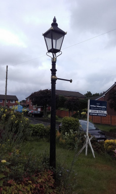 Reclaimed Black and Gold Iron Victorian Lamp Post In Garden Setting