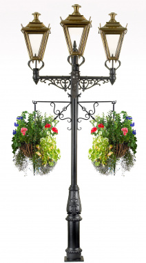 Traditional triple headed lamp post with flower baskets
