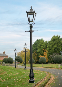 Large Victorian Lamp Post Lining A Garden Edge