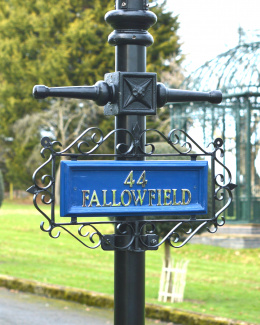 Blue and Black Ornate Scroll Wrought Iron Lamp Post Sign
