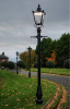 Black Victorian Lamp Post With LED Lantern Fitting At Dusk