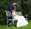 Bridge and groom on cream westminster bench