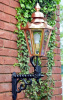 Garden wall mounted light with copper lantern