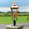 Copper Victorian Lantern On Black Pillar Mount