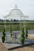 green round gazebo with table and chairs