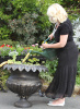 lady with watering can with cheshire hall planter