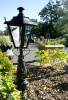 Pillar light in garden flower bed