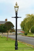 Polished Brass Kensington Lamp Post 2.25m In A Garden Setting