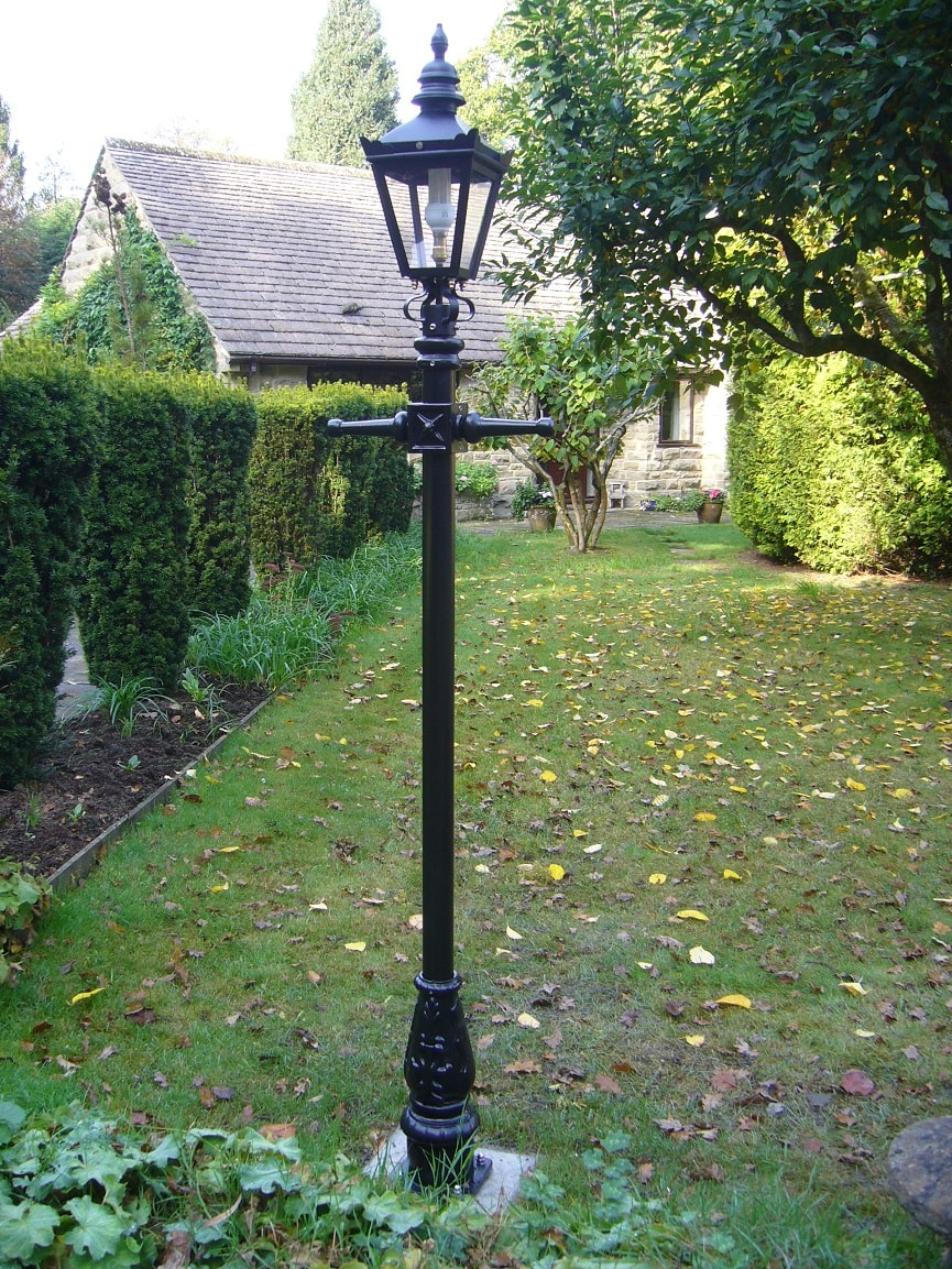 Black Lamp Post Installed In English Garden