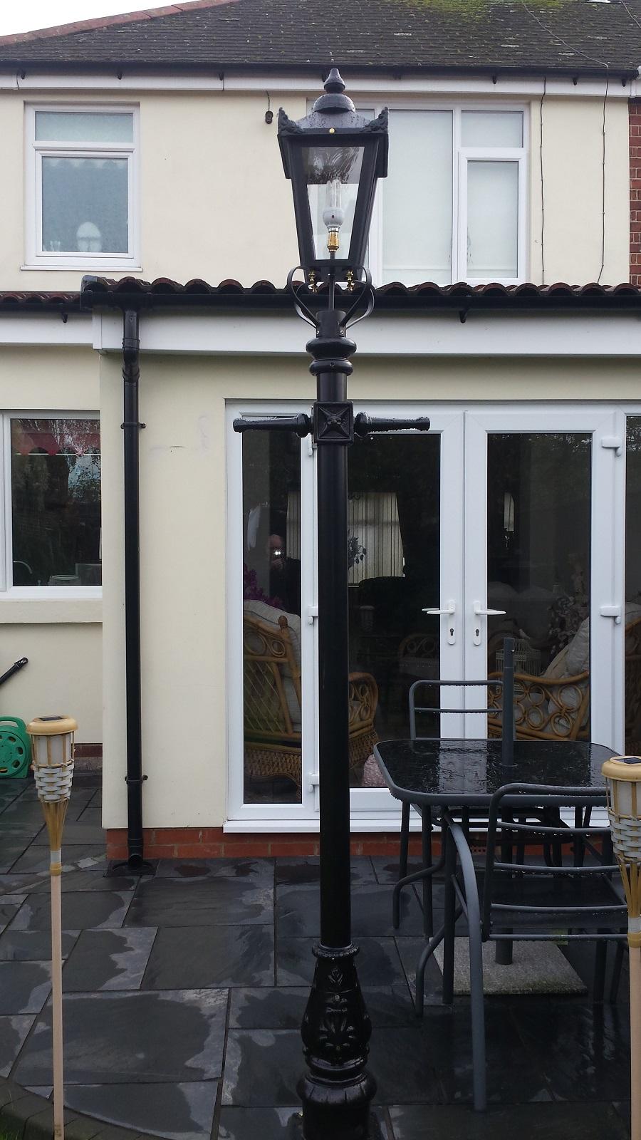Black Victorian Lamp Post on black slate patio