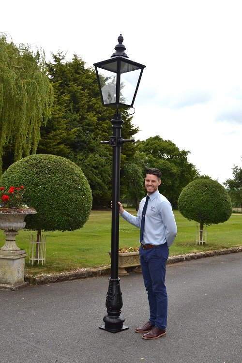 large black cast iron lamp post with rochester lantern