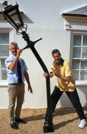 Illusionist Uri Geller mysteriously bends one of our lamp posts